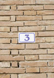 Number three on a brick wall Stock Photography