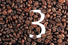Number three on coffee bean background concept Royalty Free Stock Images