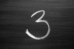 Number three enumeration written with a chalk Royalty Free Stock Images