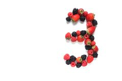 Number three with fruits. Number three made from strawberry, raspberry and blackberry fresh fruits Royalty Free Stock Images