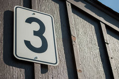 Number three on gate. A close up of a board with number three on a gate royalty free stock image