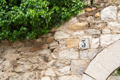 Number three on a house with green leaves Stock Photography