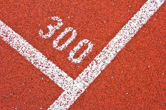 Number three hundred. On running track rubber standard red color Stock Photos
