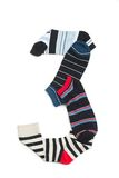 Number three. Made from dark and light colours of socks. Short socks put on white background Royalty Free Stock Photos