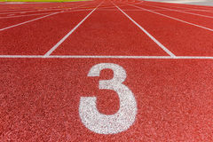 Number three on the running track Royalty Free Stock Images