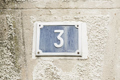 Number three on the wall of a house Royalty Free Stock Photo