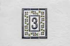 Number three on white wall Stock Photos