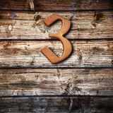 Number three on  wooden background Stock Photography