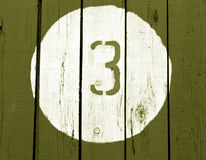 Number three on wooden  wall. Royalty Free Stock Image