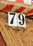 Number of tile, stand in the April Fair, Seville, Andalusia, Spain. Glazed tile with number 79 placed at the entrance of a caseta in the Seville Fair, Andalusia Royalty Free Stock Image