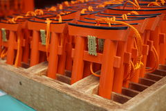 Number of tiny orange traditional Japanese gates (miniatures of Toriis) in the Shinto shrines Stock Images