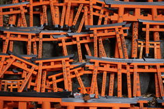 Number of tiny orange traditional Japanese gates (miniatures of Toriis) in the Shinto shrines Royalty Free Stock Image