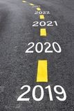 Number of 2019 to 2023 on asphalt road surface. With marking lines, happy new year concept royalty free stock images