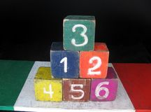Number 3 is on top of pyramid made of 6 numeric blocks. Number three is on top of pyramid made of six numeric blocks Royalty Free Stock Images