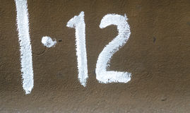 Number twelve  on the metall plate Royalty Free Stock Photography