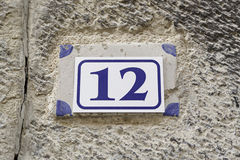 Number twelve on a plate on a wall Stock Photo