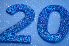 Number twenty blue color over a blue background. Anniversary. Horizontal Royalty Free Stock Images
