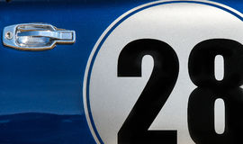 Numer twenty eight. The number twenty eight on the door of a blue car Royalty Free Stock Photography