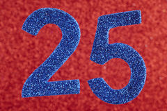 Number twenty-five blue color over a red background. Anniversary Royalty Free Stock Images