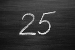 Number twenty five enumeration written with a chalk Stock Image