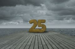 Number twenty five. On wooden floor at ocean Royalty Free Stock Photos