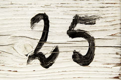 Number twenty-five in wood Stock Photography