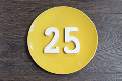 The number twenty-five on the yellow plate. Royalty Free Stock Photography