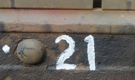 Number twenty-one on the metall plate Stock Photography