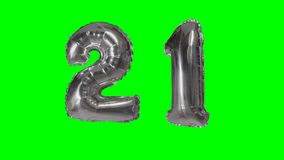 Number 21 twenty one years birthday anniversary silver balloon floating on green screen -. Number 21 twenty one years birthday anniversary silver balloon stock video