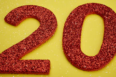 Number twenty red color over a yellow background. Anniversary. Horizontal Stock Photography