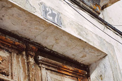 Number twenty seven. A house number, 27, on an old stone door Stock Images