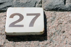 Number twenty seven. On a metal plate Stock Image