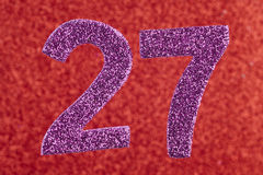 Number twenty-seven purple color over a red background. Annivers. Ary. Horizontal Stock Image