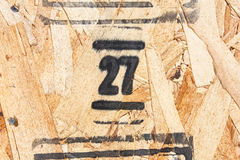 Number twenty seven on Wooden Panel. Number twenty seven on Pressed Wooden Panel Royalty Free Stock Images