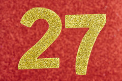 Number twenty-seven yellow color over a red background. Annivers Stock Photos