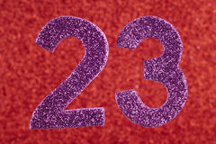Number twenty-three purple over a red background. Anniversary. Royalty Free Stock Photography