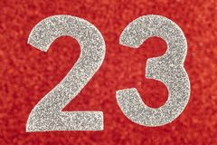 Number twenty-three silver over a red background. Anniversary Stock Photography