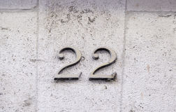 Number twenty two on a wall Stock Photos