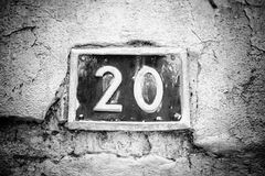 Number twenty on the wall of a house stock photography