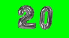 Number 20 twenty years birthday anniversary silver balloon floating on green screen -. Number 20 twenty years birthday anniversary silver balloon floating on stock video