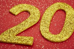 Number twenty yellow color over a red background. Anniversary. Horizontal Stock Images