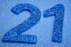 Number twentyone blue color over a blue background. Anniversary. Horizontal Stock Image