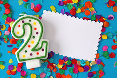 Number two birthday candle. On blue background Royalty Free Stock Photography