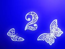 Number two and butterfly cut from white paper stock photography