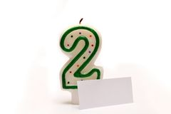 Number two candle and tag Royalty Free Stock Photos