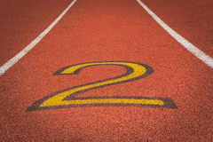 Number two - 2. Detail - number two - of a red athletics race track Stock Photography
