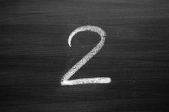 Number two enumeration written with a chalk Royalty Free Stock Photography
