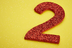 Number two red color over a yellow background. Anniversary. Horizontal Stock Images