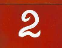 Number two on red metal wall. Stock Photos