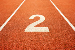 Number two on running track. Number two on athletics all weather running track Stock Photo